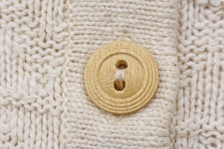 purls: wooden button on knitwear - knitting pattern with purls and knits