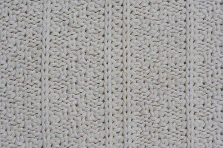 purls: Close-up of a woolen pattern - knitting pattern with purls and knits -