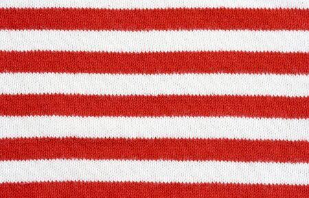 plain stitch: red and white striped fabric - plain knitting  Stock Photo