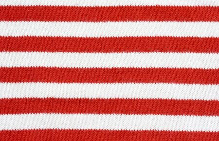 red and white striped fabric - plain knitting  Stock Photo