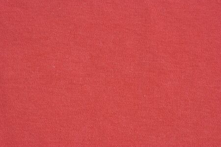 Close-up of a red woolen pattern - plain knitting Stock Photo