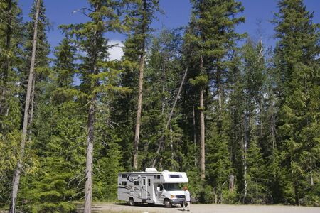 motorhome: Big Motorhome with owner in the woods - Wells Gray Provincial Park, British Columbia, Canada Stock Photo