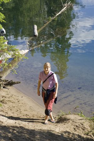 capri pants: Young woman on a lakeshore - Clearwater Lake, Wells Gray Provincial Park, British Columbia, Canada