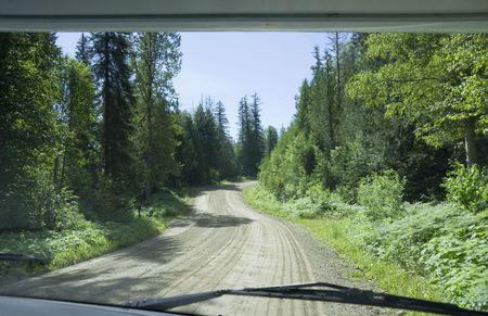 Gravel road seen through windshield - Wells Gray Provincial Park, British Columbia, Canada Stock Photo