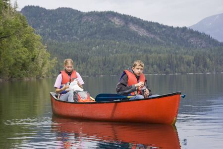 canoeing: Girl and boy canoeing - Clearwater Lake, Wells Gray Provincial Park, British Columbia, Canada