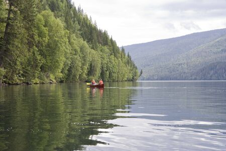 Clearwater lake with canoe - Wells Gray Provincial Park, British Columbia, Canada photo