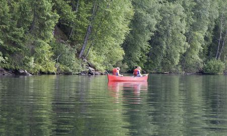 Exhausted girl and boy canoeing - Clearwater Lake, Wells Gray Provincial Park, British Columbia, Canada photo