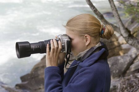 telephoto: Young photographer with telephoto lens - Fraser River, Rearguard Falls Provincial Park, Canadian Rockies, British Columbia
