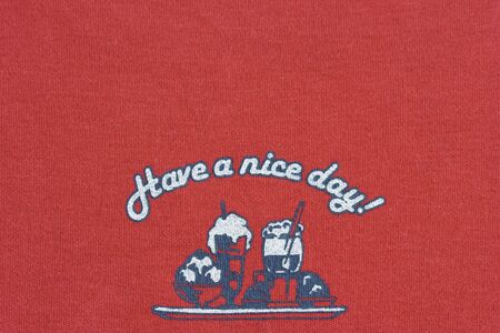 Close-up of a design on fabric - have a nice day photo