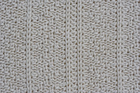 Close Up Of A Woolen Pattern Knitting Pattern With Purls And