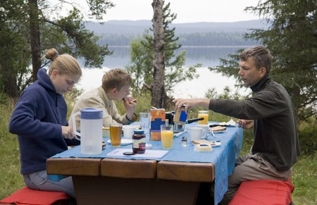 Family having breakfast outdoors � Green Lake, South Cariboo, British Columbia, Canada