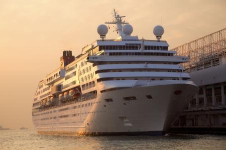 cruise liner: Cruise Ship docked at Ocean Terminal at Sunset - Tsim Sha Tsui, Kowloon, Hongkong Stock Photo
