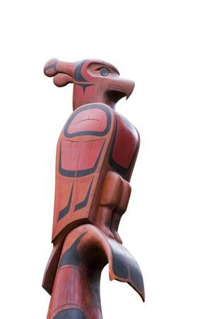the totem pole: Top of a Totem Pole - Pacific Rim National Park, Vancouver Island, British Columbia, Canada - Totem Pole of the Ucluelet First Nation on the South Beach Trail with a thunderbird, killer whale, bear and a salmon Stock Photo