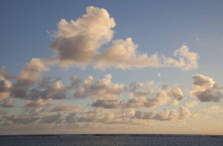 Cumulus Clouds above South Pacific Ocean at Sunset - Rarotonga, Cook Islands, Polynesia photo