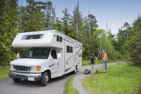 Family filling Freshwater in Motor Home at Dumping Station - Pacific Rim National Park, Vancouver Island, British Columbia, Canada Stock Photo