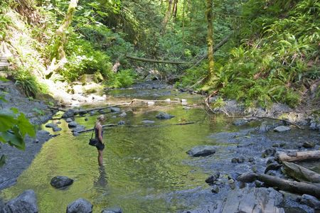 provincial forest parks: Young Woman refreshing in Stream - Goldstream Provincial Park, Vancouver Island, Canada