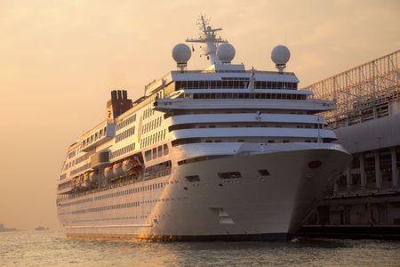 Cruise Ship docked at Ocean Terminal at Sunset - Tsim Sha Tsui, Kowloon, Hongkong Stock Photo