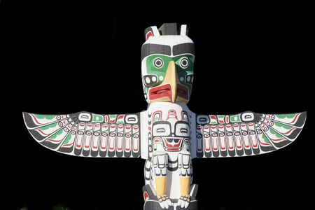 Top of Totem Pole on Black - Stanley Park, Vancouver, British Columbia, Canada photo