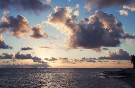 Cloudscape over Ocean and Island at Sunset - Rarotonga, Cook Islands, Polynesia photo