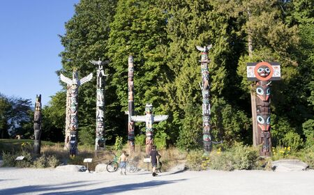 Totem Poles with Boys in Stanley Park - Vancouver, British Columbia, Canada