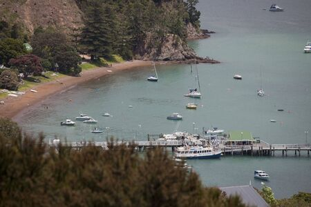 View over Beach and Harbor in Russell - Panorama in Northland, North Island, New Zealand photo