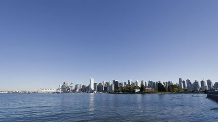 Cityscape of Vancouver, British Columbia, Canada - View from Canada Place to Deadmans Island photo