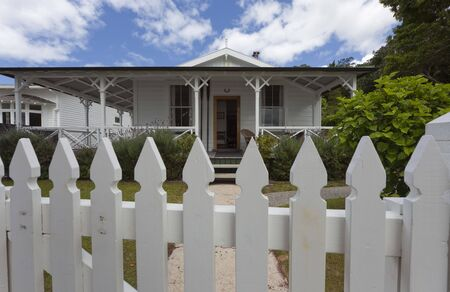 White Picket Fence in front of Detached House - Russell, Bay of Islands, Northland, North Island, New Zealand photo