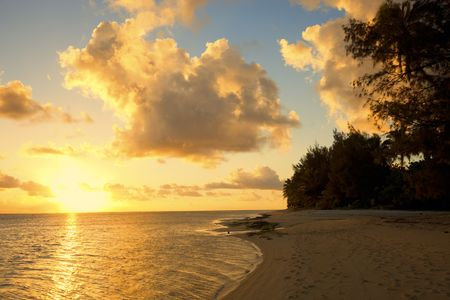 Sunset on Beach of a Tropical Island - Rarotonga, Cook Islands, Polynesia photo