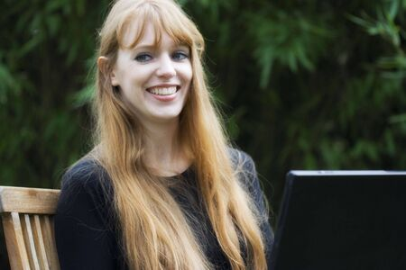 Young Woman using Laptop - outdoors Stock Photo - 5252430