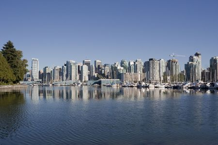 Vancouver Skyline reflected in Coal Harbor - View from Stanley Park, Vancouver, British Columbia, Canada