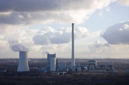 Industrial Plant with smoking Cooling Tower - Recklinghausen, North Rhine-Westphalia, Germany Stock Photo