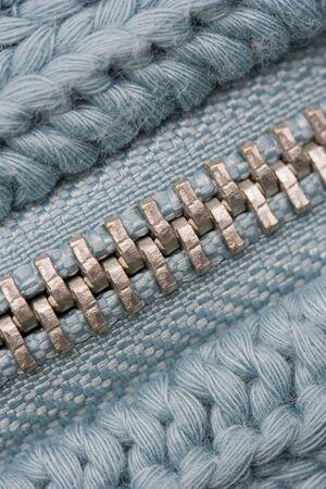 Macro of Closed Zipper on Sweater - Detail of Knitting Pattern Stock Photo