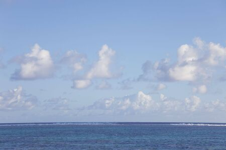 Cumulus Clouds over Tropical Lagoon in the South Pacific Ocean - Rarotonga, Cook Islands, Polynesia