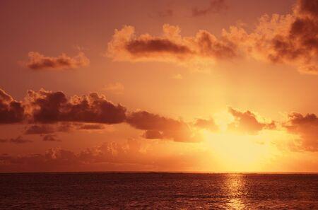 Sunset over South Pacific Ocean - Rarotonga, Cook Islands, Polynesia Stock Photo