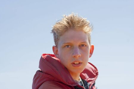 Teenage Boy with red Floatation Suit - Portrait on Whale Watching Tour photo