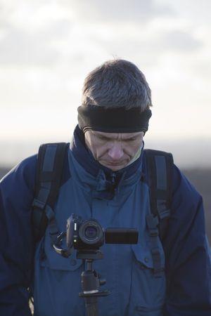 Mature Man using Camcorder - outdoors