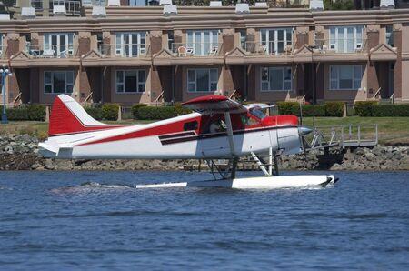 Red and White Seaplane landing - Victoria, Vancouver Island, British Columbia, Canada