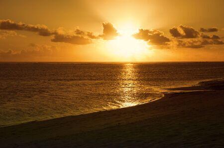 Sun shining through Clouds at Sunset - South Pacific Ocean, Rarotonga, Cook Islands, Polynesia