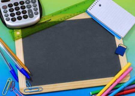 blank slate: School or office supplies surrounding blank slate blackboard Stock Photo