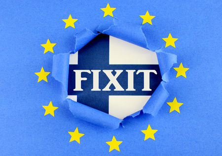 separatism: The Finnish blue and white flag is behind the torn open center of the blue flag of the European Union with gold stars. The EU flag is highly textured construction paper. Fixit text added