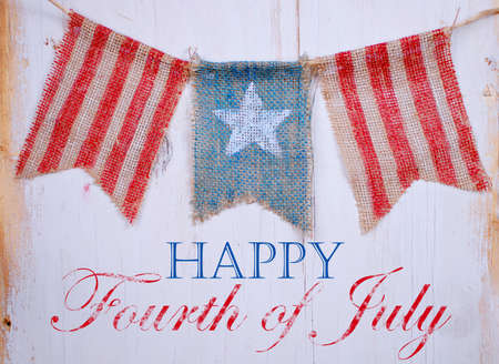 white washed: Rustic patriotic banner of three painted burlap flags on white washed wooden background. Center is white star on blue. Outside is red and white stripes with July 4th text