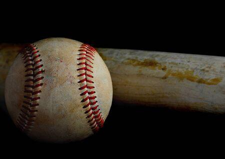 Low key image of old baseball and bat showing pine tar residue on black background. Reklamní fotografie