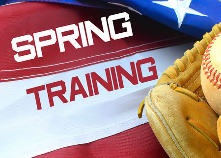 Closeup of worn baseball and mitt on a US flag background, great for Americas favorite pasttime. Spring training text added
