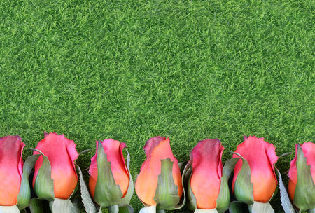 Red silk roses and artificial green grass form a bottom border. Good for the running of the thoroughbred race called the Kentucky Derby. Copy space Фото со стока