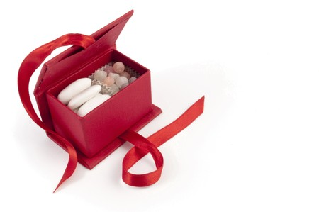 comfit: Opened wedding bonbonniere sweet box over with background