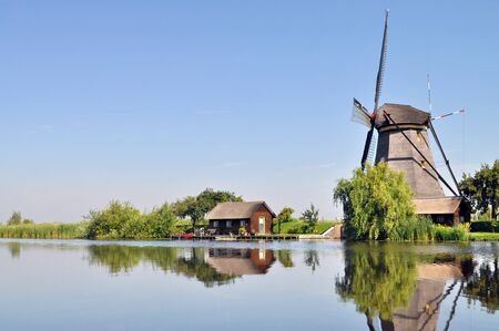 dutch canal house: Mill and house reflecting into a dutch canal