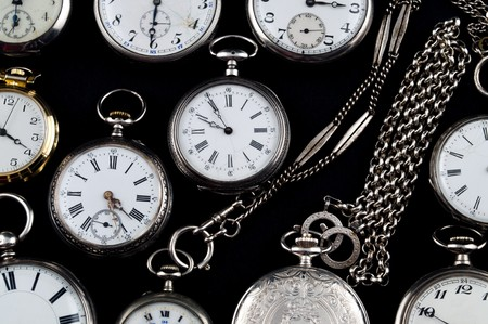 Background of cracked silver pocket watch on black photo