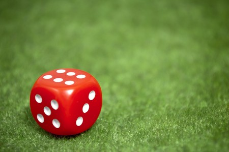 Casino Red die over a green carpet