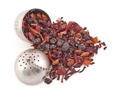 tea filter: tea filter full of red tisane leaves and dried fruit Stock Photo
