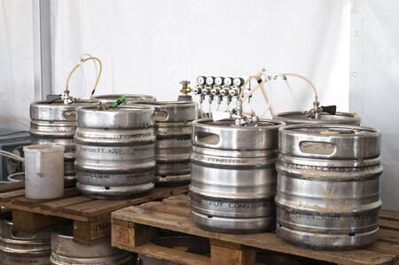 Steel indutrial barrels of beer stocked in storage Stock Photo - 7434790